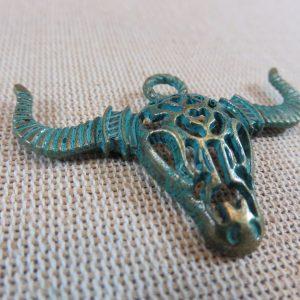 Pendentif tête buffle bronze patiné crane taureau corne
