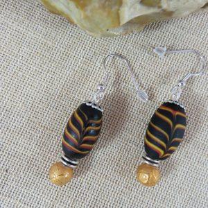 Boucles d'oreille ethnique grosse perles noir et doré – bijoux femme