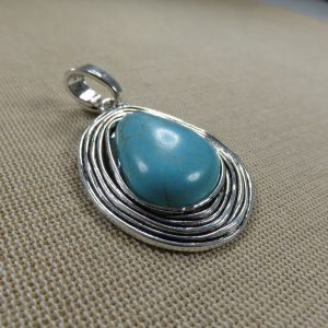 Pendentif ovale bohème 60mm métal coloris argenté cabochon effet pierre turquoise