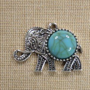 Pendentif éléphant Ganesh argenté avec cabochon effet turquoise
