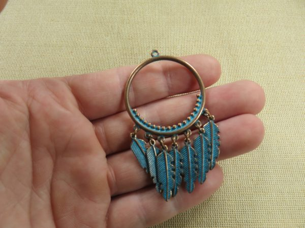 Pendentif bohème plume métal couleur cuivre patiné antique