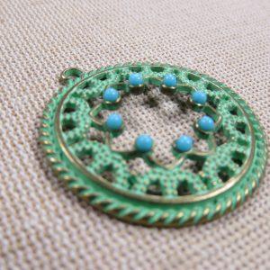 Pendentif rond bronze patiné perlé en relief